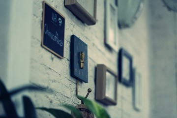 Home decoration wooden picture frame hanging on wall closeup vintage style blur background