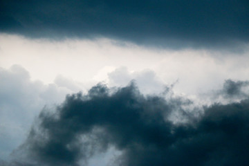 saturated storm clouds against the dark sky, dark blue tint