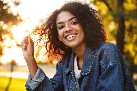 Smiling young african girl in denim jacket