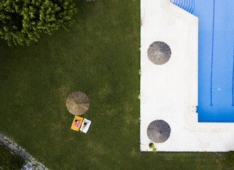 Aerial shot of women resting at poolside