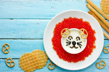 Fun and creative snack idea for kids - lion shaped sour cream red caviar dip bowl with crackers