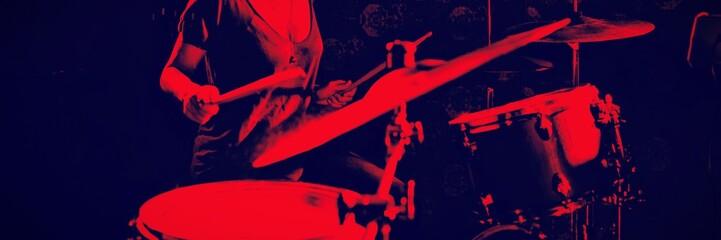 Confident female drummer performing in nightclub
