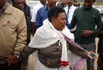 A woman reacts at the scene, where Ethiopia's Grand Renaissance Dam Project Manager Simegnew Bekele was found dead in his car in Addis Ababa