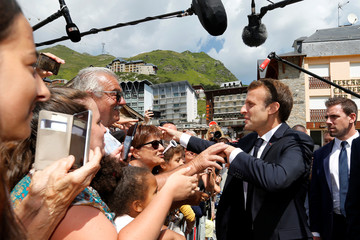 French President Emmanuel Macron greets people as he arrives to visit the Pic du Midi in the Pyrenees mountain at La Mongie in Bagneres-de-Bigorre
