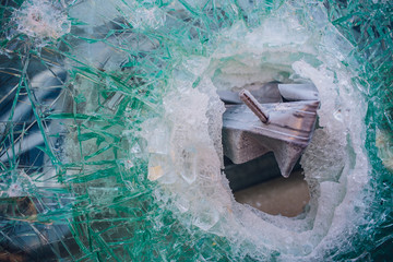 photo broken window looks like bullet hole