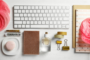 Creative flat lay composition with tropical flowers and computer keyboard on wooden background