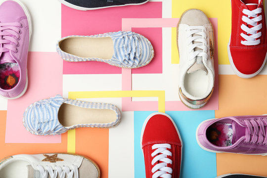 Flat lay composition with stylish new shoes on color background