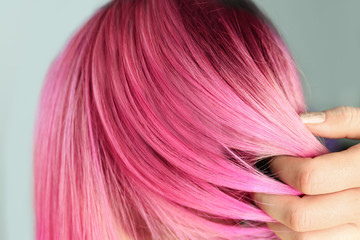 Woman with color dyed hair, close up view. Trendy hairstyle