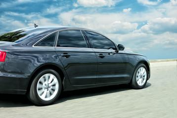 black  car moves