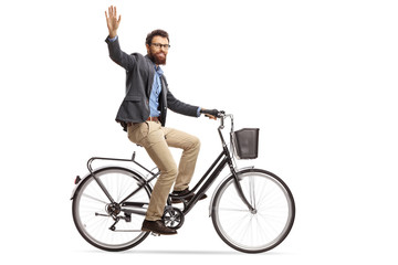 Bearded man riding a bicycle and waving at the camera