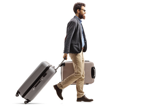 Young man with suitcases walking
