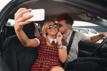 Happy Couple Taking Selfie In The Car
