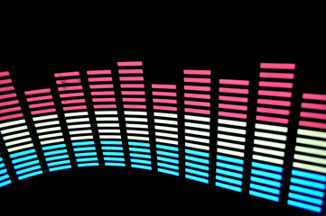 Stylish light panel of pixels, neon with blue or green, yellow and red, a bright equalizer in a dark background
