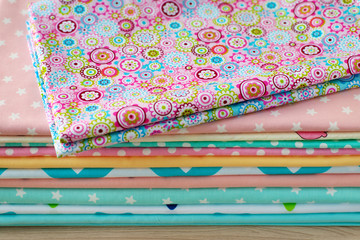 Colorful cotton fabric. A lot of cotton fabric for sewing clothes or bedding. Natural cloth and tailoring.