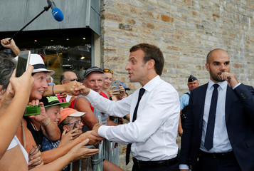 French President Emmanuel Macron greets people after his visit to the Pic du Midi in the Pyrenees mountains at La Mongie in Bagneres-de-Bigorre