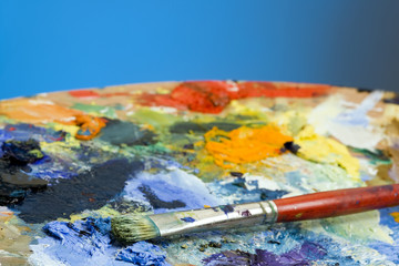 An artists paint palette and brush