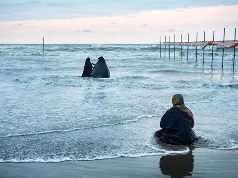 Black islamic dressed women, Caspian sea, Iran