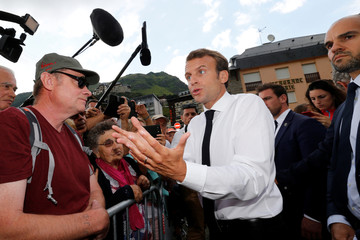 French President Emmanuel Macron stops to speak to people after his visit to the Pic du Midi in the Pyrenees mountains at La Mongie in Bagneres-de-Bigorre