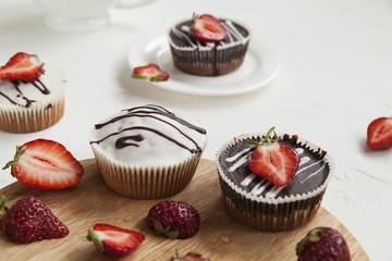 chocolate cupcakes with strawberries, muffins and fresh strawberries