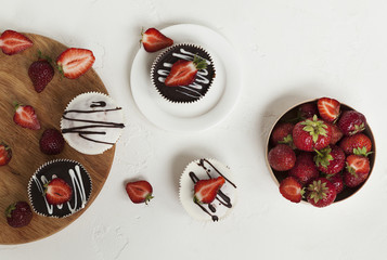 chocolate cupcakes with strawberries, muffins and fresh strawberries