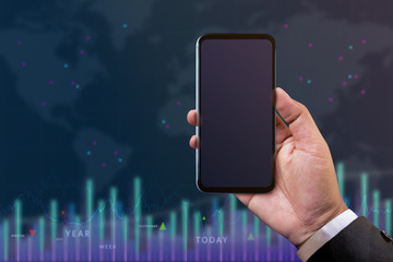 Smartphone Mockup for Investment and Analysis concept. Businessman holding Mobile Phone over the blurred Chart of Financial Stock Marketing. Mobile Screen as Clipping Path