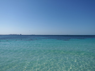 Tropical view of turquoise waters of Caribbean Sea landscape with horizon line at Cancun city in Mexico