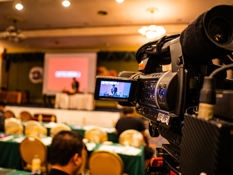 Close up Professional Video Camera in conference hall or seminar room with attendee background,Education concept