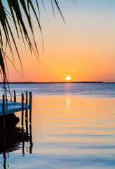 Florida sunset with gentle ripples in water.