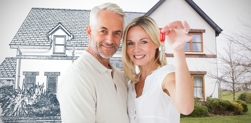 Composite image of happy couple showing their new house key