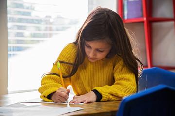 Girl in classroom at Montessori school