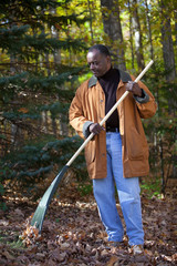 Senior African American Man Raking Leaves