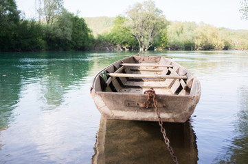 old wooden boat on the river