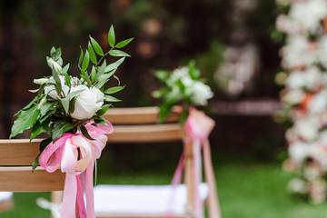 Graceful bouquet buttonhole on a chair.