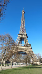 View of The Eiffel Tower in a clear day with blue Sky