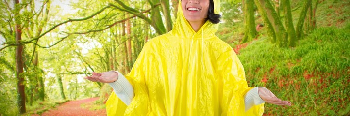 Composite image of woman in yellow raincoat gesturing to feel