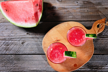 Watermelon cocktail on a wooden table.