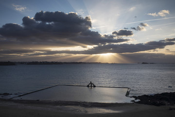 The swimming pool at sunset on the Plage de Bon Secours, St. Malo, Ille et Vilaine, Brittany, France