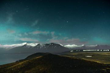 Northern lights on the Diamond beach in south east Iceland, Jokursarlon Vik ice rocks ocean
