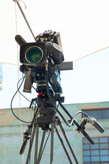 Professional video camera for broadcasting on a tripod