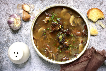 Thick dried mushroom soup with garlic and thyme.Top view.