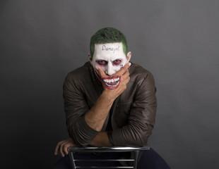 dark creepy joker face screaing angry. green hair