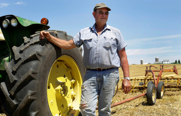 Farmer Mark Klinger poses for a portrait on his tractor at his farm in Pecatonica