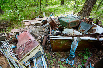 Dump old metal objects in the woods, rusty scrap metal.  Environ