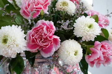 The bouquet of pink carnation and white chrysanthemum, Beautiful fresh blossoming flower as a background, Wedding décor, Side view