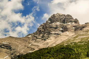 Great Rocky Mountains under magnificent clouds and sunlight, at Banff National Park, Calgary, Canada
