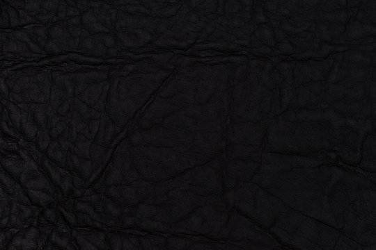 Black leather texture. Top view.