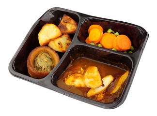 Roast chicken ready meal with Yorkshire pudding and vegetables isolated on a white background