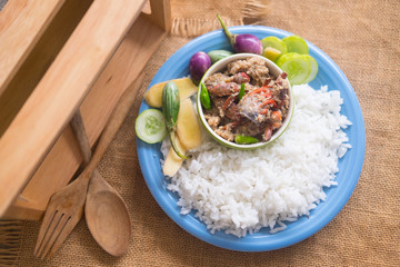 Soya bean dipping sauce served with steamed rice