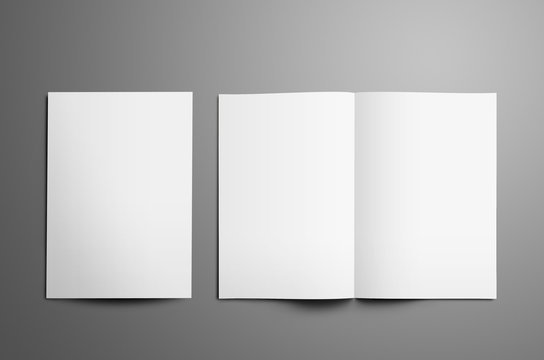Universal tempalte with two white  A4, (A5) bi-fold brochures isolated on gray background.