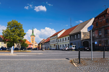 Kravare, Machuv kraj, Czech republic - July 14, 2018: intersection near the square with parked cars, historical houses and church in summer